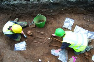 Recording and lifting one of the burials