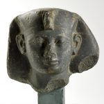 A statue head in fine green Arkose of a king