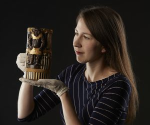 Dr. Margaret Maitland inspects a decorative box inscribed for King Amenhotep II