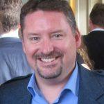 Headshot photograph of Dr Simon Gilmour