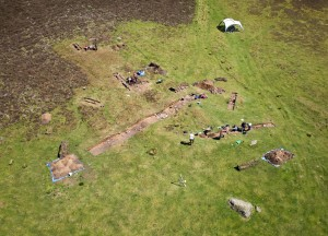 An aerial view showing the scale of the longhouse group and 2015 trenches.
