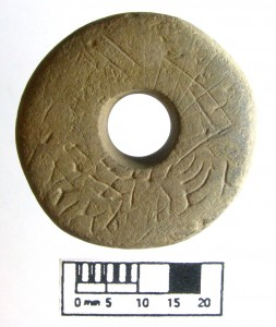 The incised spindle whorl found within the longhouse in 2015