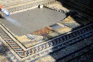Hole cut through Roman floor mosaic