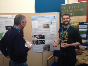 Tom presenting his poster at the AEA, April 2016