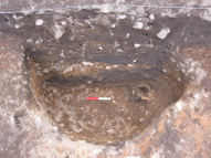 stone hole with human skull placed at the base