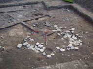 stone foundations of a small rectangular building