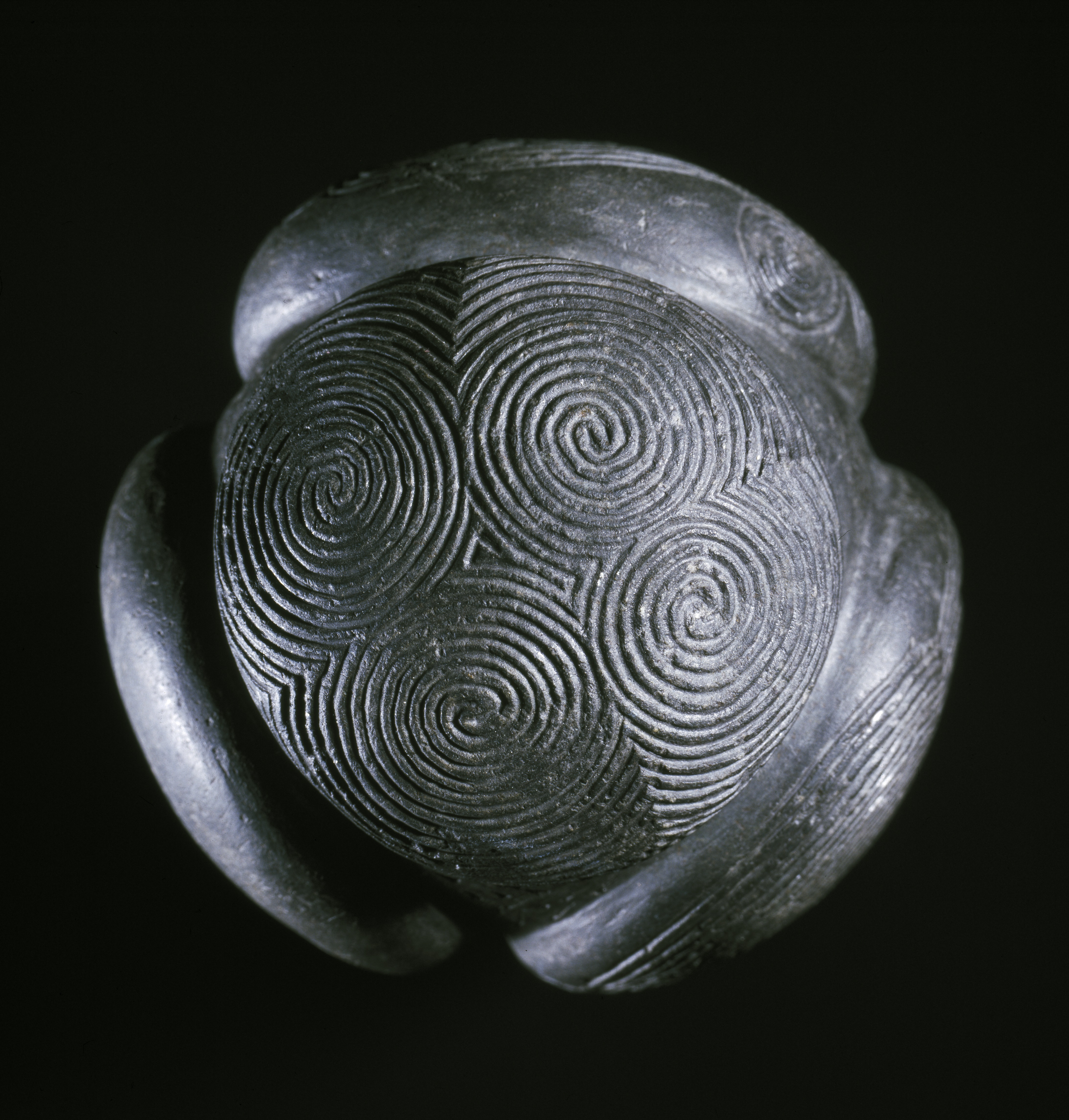 spiral-decorated-face-of-the-towie-carved-stone-ball-c-national-museums-scotland